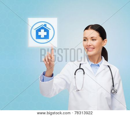 healthcare, medicine, people and technology concept - smiling young doctor or nurse pointing to icon or pressing button with pills and blood images over blue background