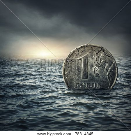 Ruble coin sinking in water.Russian economic crisis concept
