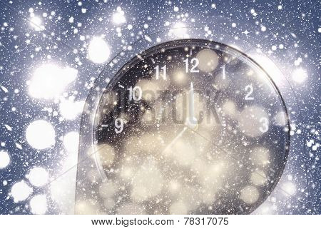 New Year's at midnight - old clock on bokeh background