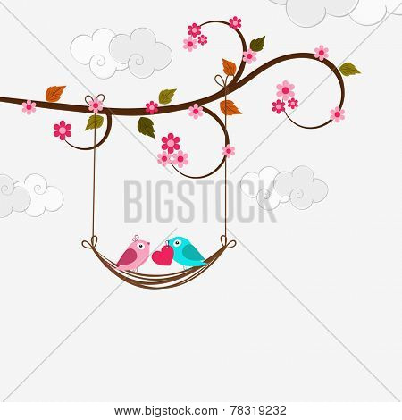 Cute love birds couple holding a pink heart and swinging on branch of tree on cloudy background for Happy Valentine's Day celebration.