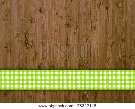 Traditional wooden background with green tablecloth