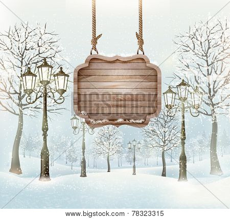 Winter landscape with lampposts and a wooden ornate Merry christmas sign.
