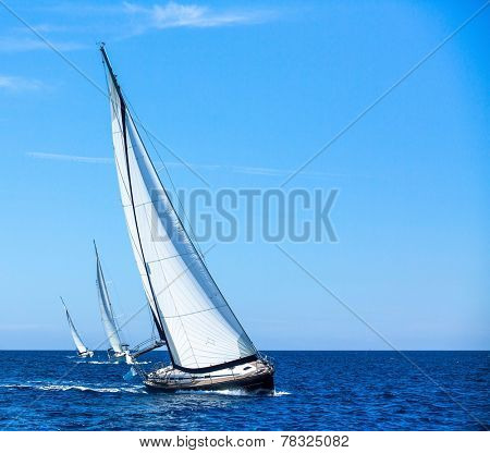 Sailing in the Sea. Race cruising yachts. Luxurious lifestyle. Luxury yachts.