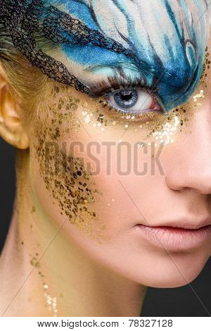 Young woman with fantasy make up. Close up