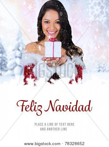 pretty girl in santa outfit holding gift against feliz navidad