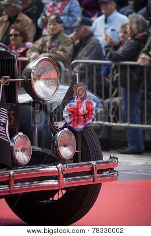 NEW YORK - NOV 11, 2014: Close up of the front fender of a vintage car with a VFW medallion and POW/MIA flag during the 2014 America's Parade on Veterans Day in New York City on November 11, 2014.