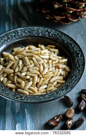 Pine nuts on a metal plate