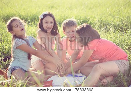 Group Of Children Playing On Grass