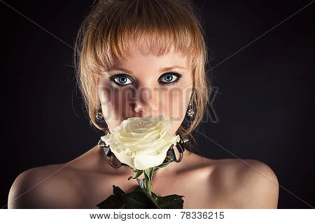 face of woman with white rose
