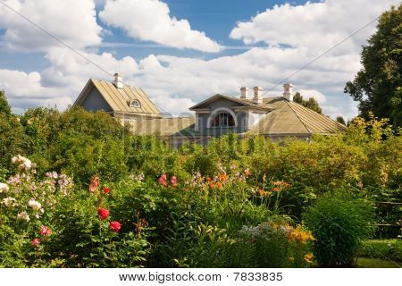 wooden country house with front garden