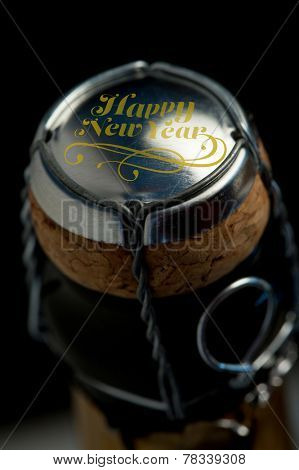 Elegant happy new year against overhead of top of champagne bottle