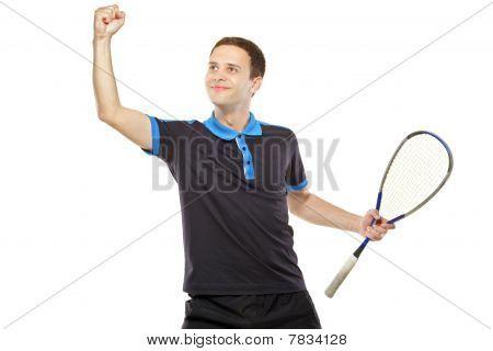 A happy squash player celebrating a score