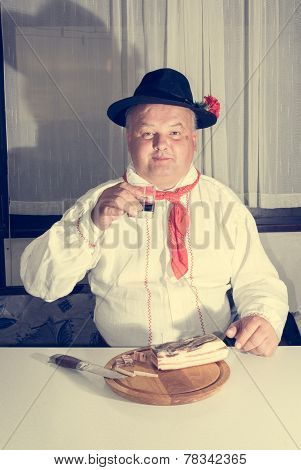 Man Wearing Traditional Clothing Enjoying A Glass Of Wine