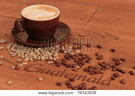 Espresso And Spilled Coffed Beans On An Egraved Table