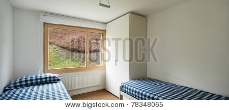 Architecture, comfortable apartment, empty bedroom with two single beds and closet
