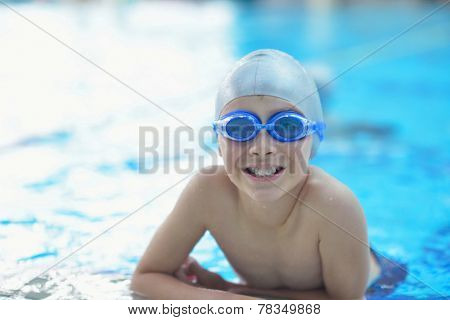 group of happy kids children   at swimming pool class  learning to swim