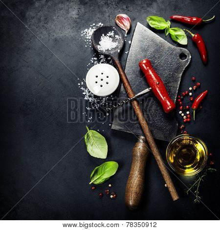 Vintage cutlery and fresh ingredients on dark background