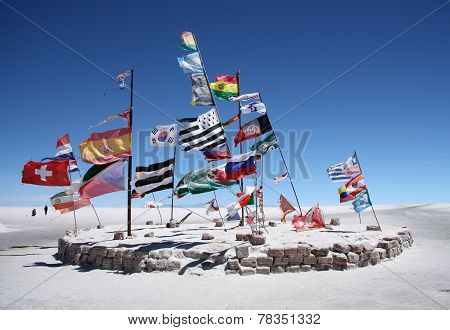 Flags in a salt desert of Salar de Uyuni