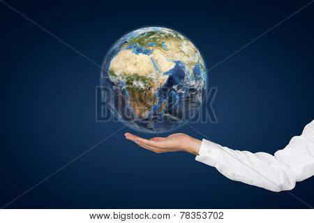 Hand Holding Planet.