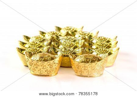 Stack Of Chinese Gold Ingots On White