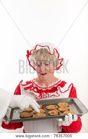 Santa's Hand Stealing A Cookie