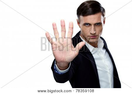 Buisnessman making stop gesture. Focus on a hand