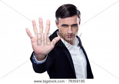 Buisnessman making stop gesture over white background