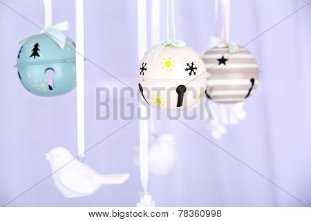 Hanging Christmas toys on light background