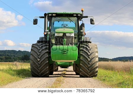 John Deere 7280R Agricultural Tractor On A Rural Road