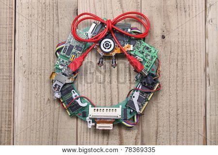 geeky christmas wreath made by old computer parts hanging on wooden door, computer parts recycling idea, christmas card design