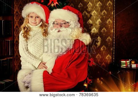 Santa Claus holds on hands happy little girl. Christmas scene.