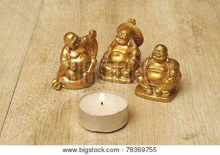 Three Buddha figurines