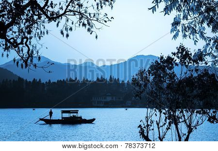 Chinese Wooden Recreation Boat Floats On The Still Water