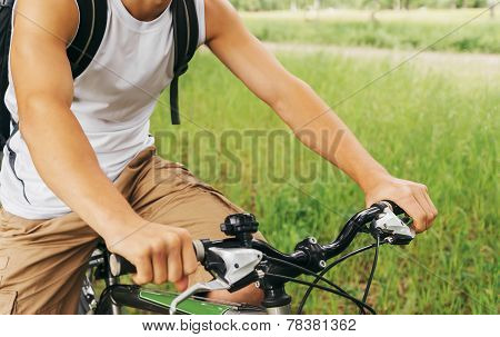 Cyclist Man Holding Handlebar Of Mountain Bike