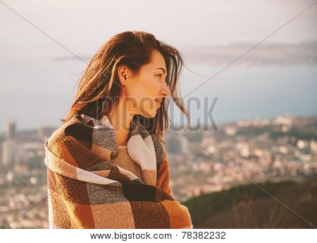 Smiling Woman Wrapped In Plaid In Autumn