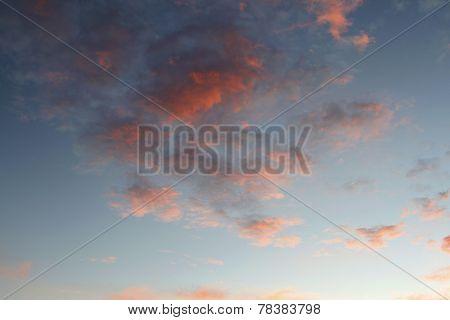 Sunlit clouds in summer sky