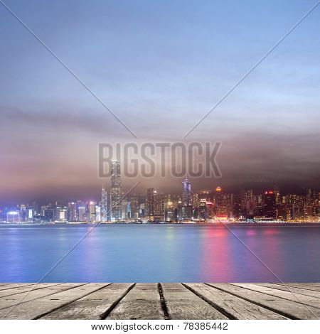 City night scenes of Victoria harbor in Hong Kong with copyspace on heaven.