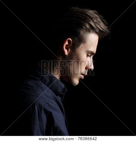 Profile Of A Sad Man Face Crestfallen On Black