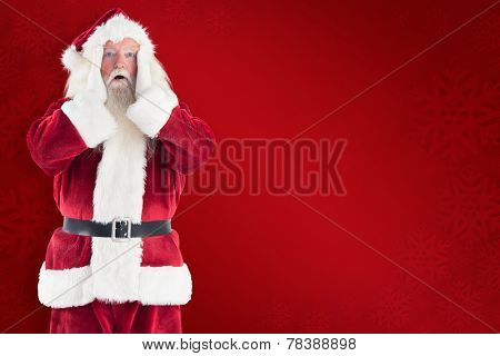 Santa is shocked to camera against red background