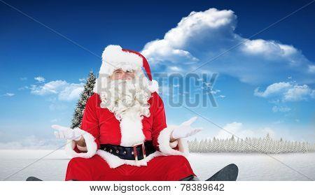 Doubtful santa sitting alone against fir tree in snowy landscape
