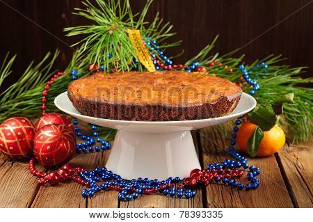 Christmas Cake On White Plate With Fur Tree, Tangerine And Christmas Toys