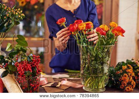 Female florist working in design studio