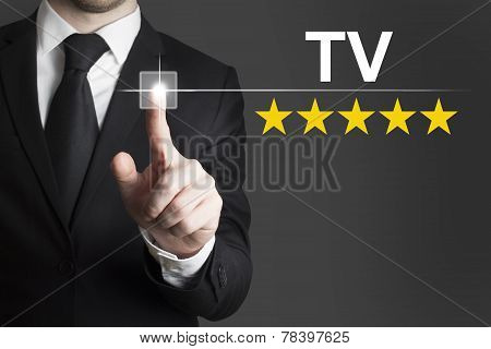 Businessman Pushing Button Tv