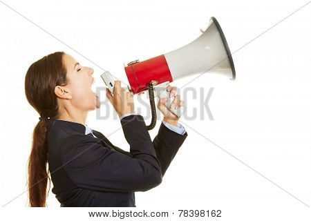 Angry business woman screaming loud into a big megaphone