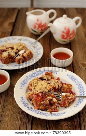 Plum Crumble With Black Tea On Wooden Background
