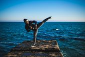 stock photo of karate  - karate training on the shores of the  sea - JPG