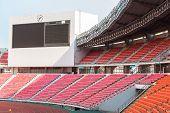 stock photo of bleachers  - red seats on the stadium steps bleacher - JPG