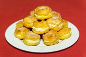 stock photo of cream puff  - Delicious tasty cream puff pile on white plate  - JPG