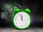 stock photo of count down  - Alarm clock counting down to twelve against wooden planks - JPG