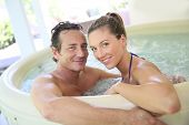 picture of hot-tub  - Romantic couple relaxing in hot tub - JPG